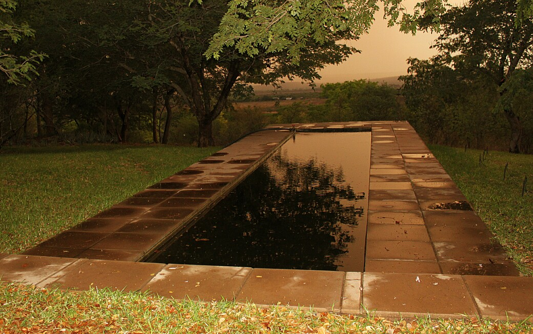 Evening light on the horizon pool after it rained.