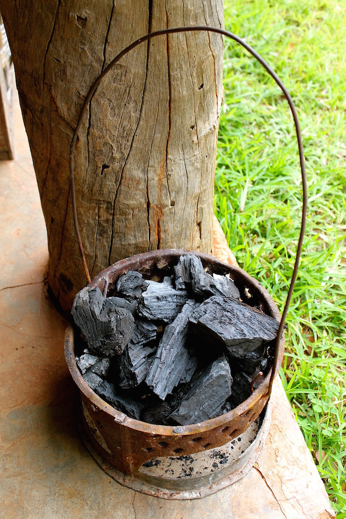 A Zambian mbaula packed with charcoal, ready to be lit.