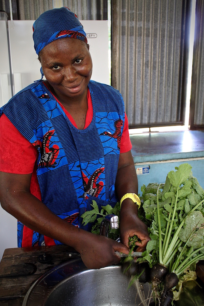 Adelina Banda preparing our black radishes, a seed gift from one of our neighbors.
