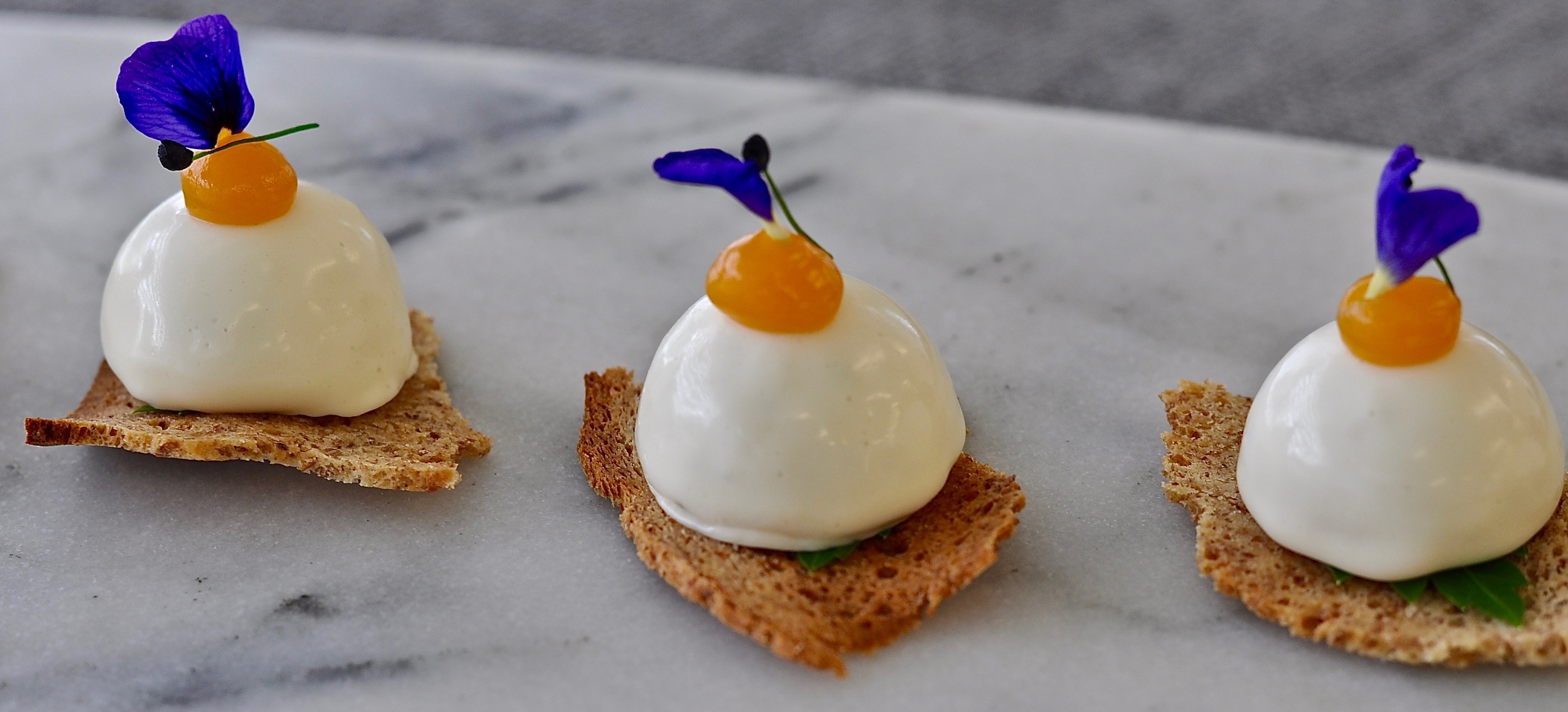 Chicken & Buttermilk Sphere, Lemon Thyme, Crisp Soda Bread & Apricot Gel.
