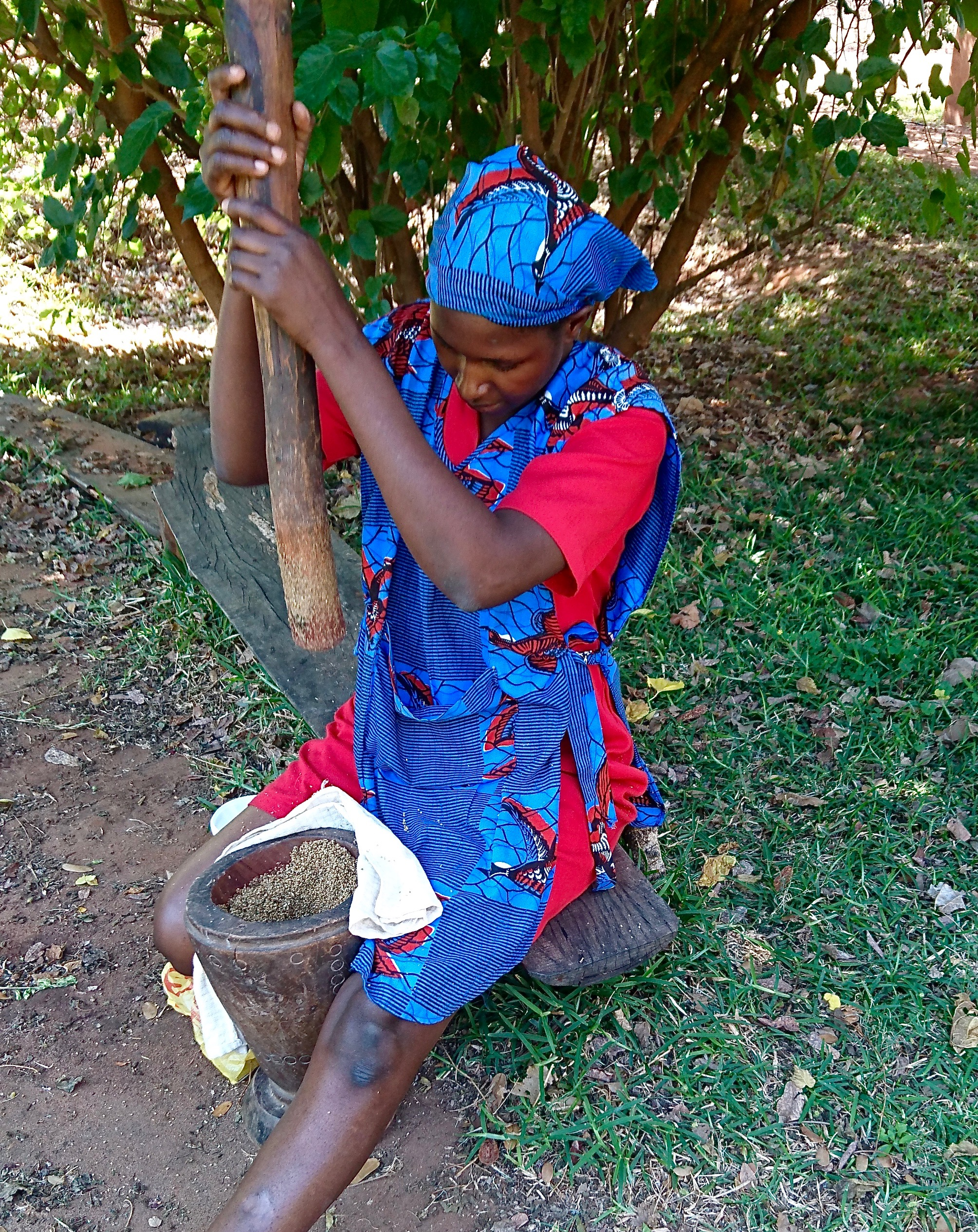 recipe-testing-sandra-libetwe-showing-me-how-to-dehusk-the-nzembwe-finger-millet